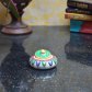 Green and blue sindoor holder