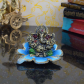 Metal lord ganesha statue on leaf