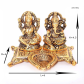figurine of goddess Laxmi and lord Ganesh with attached diya