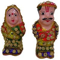 Plaster of Paris made idols of Rajasthani couple with Jaipuri artwork