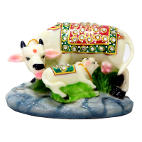 A Flamboyant Set Of Resin Crafted Cow Calf Pair