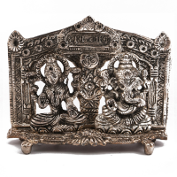 Oxidised metal Laxmi and Ganesh figure
