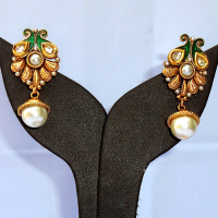 Designer earrings studded with white pearls