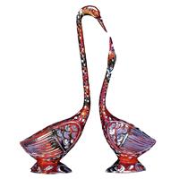 Intricate meenakari worked metal swan pair