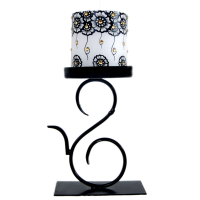 Intricate wrought iron candle holder