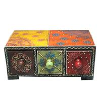Ethnic chest drawers crafted from wood and ceramic