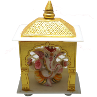 Ganesha idol made of soft marble inside the acrylic temple