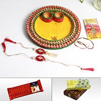 Send rakhi to India with wooden kundan pooja thali, sweets and chocolates