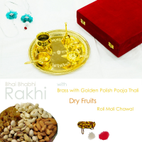 Golden polished pooja thali with  rakhi for bhaiya, dryfruits