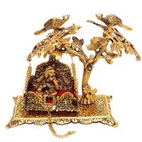 Metallic idol of Lord Kanha on Jhula
